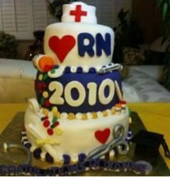 3 Tier graduation cake with Nurses.JPG