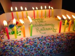 big fun birthday cake with alot of candles.jpg