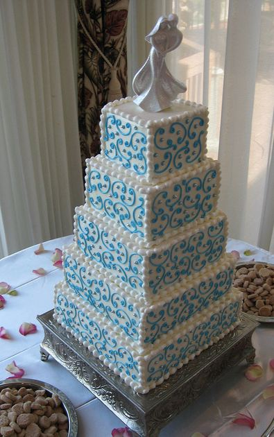 Five tier white wedding cake with pearls and blue accent.JPG
