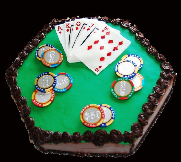 Hexagonal poker table cake with cards and chips.JPG