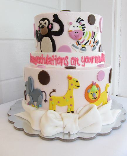 Picture of 2 tier animal theme light pink baby shower cake