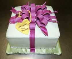 White square birthday cake with purple bow and yellow heart.JPG
