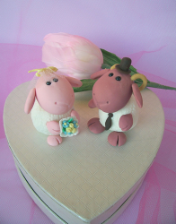 cute sheep and ram wedding cake toppers with heart shape stand.PNG