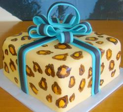 Gift box cake with blue bow and leopard spots.JPG