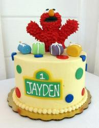 First birthday cake with Elmo and pokadots.JPG
