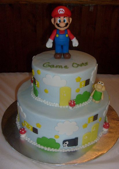 Two tier Super Mario cake with Mario topper.JPG
