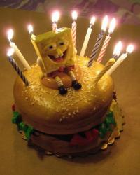 Spongebob Squarepants Crabby Patty cake with lit candles.JPG