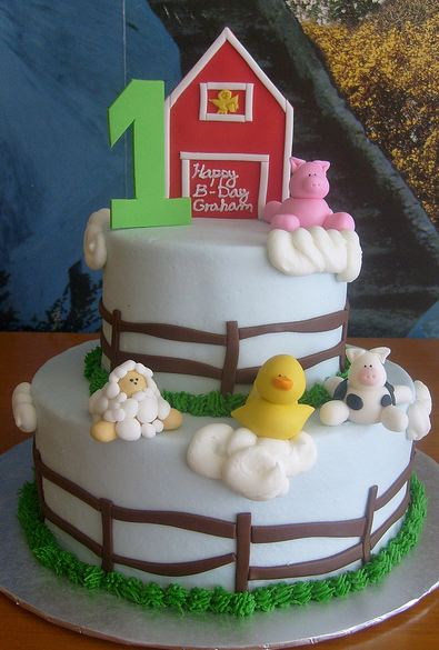 Two tier white round farm theme first birthday cake with pigs and duck and sheep.JPG