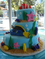 Three tier ocean theme cake with fish, shells, sand and starfish.JPG
