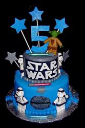 2 tier Star Wars theme birthday cake with Yoda and stormtrooper for kids.JPG