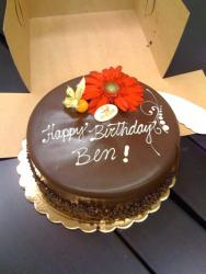 chocolate birthday cake with fresh flowers.jpg