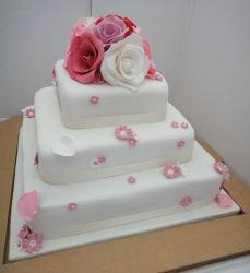 3 tier white rectangular wedding cake with pink red and white roses.JPG