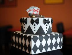 Two tier Groom's cake with bowtie tux pattern and poker card and cigar topper.JPG