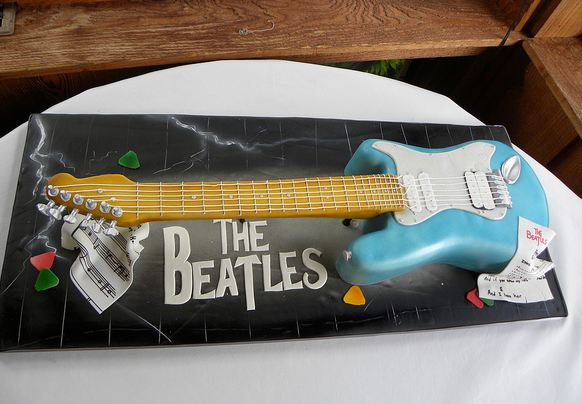 Beatles theme electric guitar cake.JPG