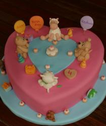 Heart shape pink birthday cake with puppies and sheep.JPG