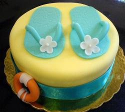 Yellow round cake with blue sandals and orange lift float.JPG