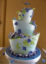 Three tier topsy turvey wedding cake in light blue with butterfly and flowers.JPG