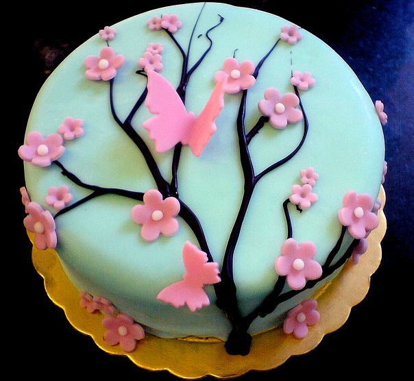 Blue round cake with pink blossoms.JPG
