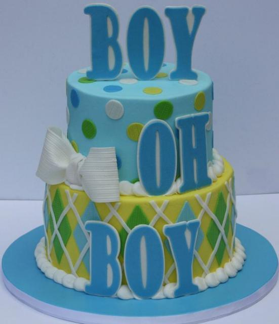 photo of 2 tier circular baby shower cake for boy in powder blue