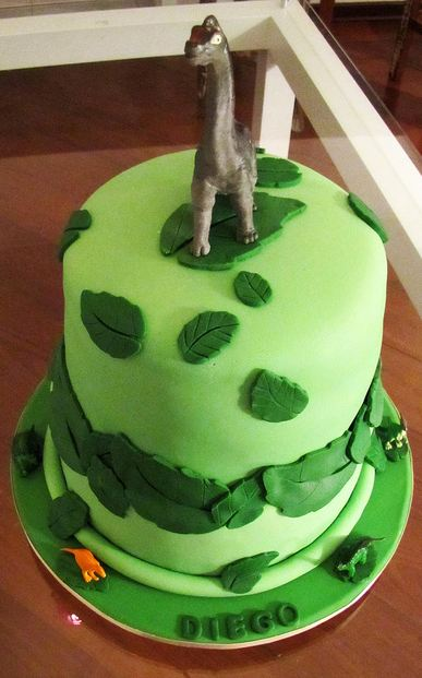 Two Tier Green Cake With Dinosaur On Top Jpg