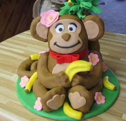 Monkey cake with bananas and pink flowers.JPG