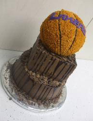 Three tier Los Angeles Lakers chocolate cake with basketball on top.JPG