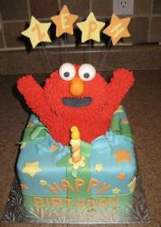 Elmo popping out of gift box birthday cake.JPG
