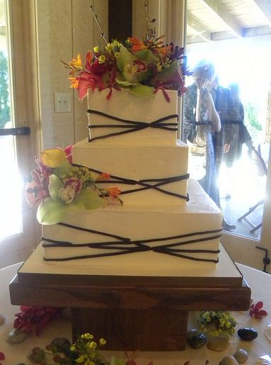 three tier square ivory wedding cake with chocolate