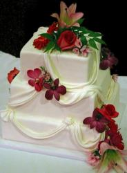 Three tier square light pink wedding cake with red roses.JPG