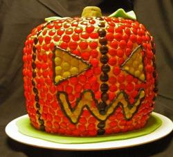 Carved pumpkin Halloween cake with Reese's Pieces and chocolate.JPG