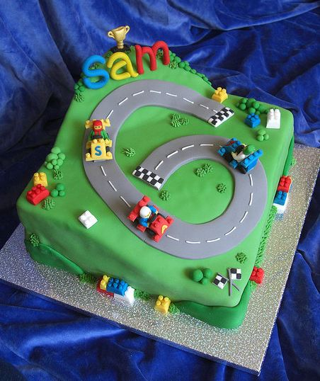 Lego race track theme birthday cake on figure 8 race cars