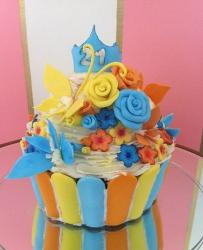 Cupcake cake with cake flowers for 21st birthday.JPG