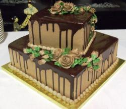 Two tier square chocolate cake with chocolate roses.JPG