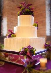 3 tier fluted butter cream wedding cake with flowers.JPG