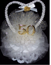 Classic 50th anniversary cake topper with pearl heart shape ring.PNG