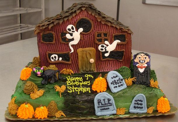 Haunted house theme Halloween birthday cake with Dracula and ghosts and tombstones.JPG