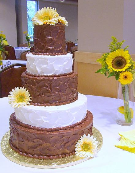 Five tier chocolate and white butter cream wedding cake with sunflowers.JPG