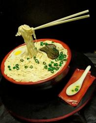 Asian soup noodles cake with chopsticks and spoon.JPG