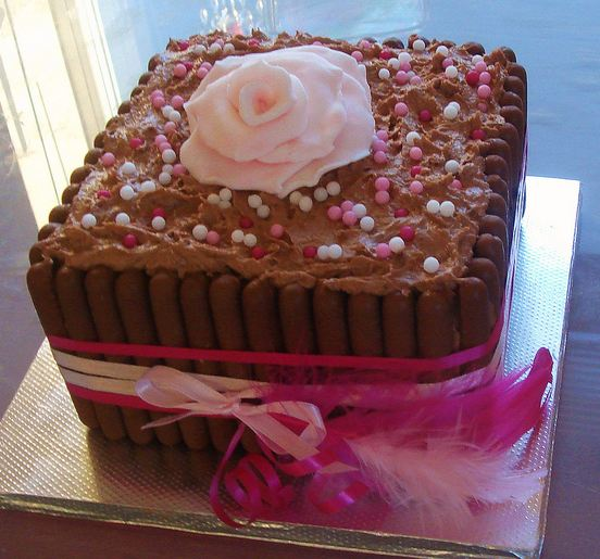 Chocolate birthday cake with pink ribbon and rose on top.JPG