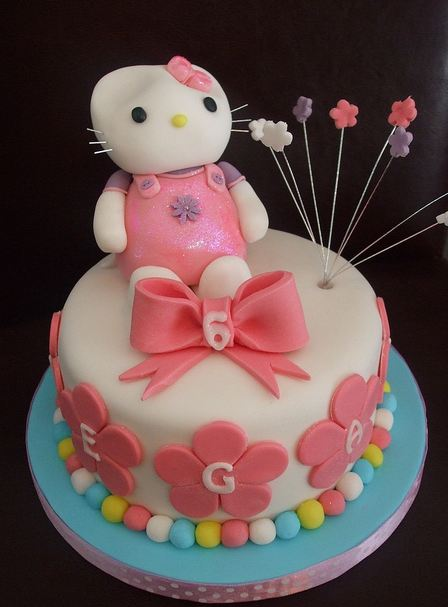 Hello Kitty Six Year Old Cake With Pink Flowers And Ribbon