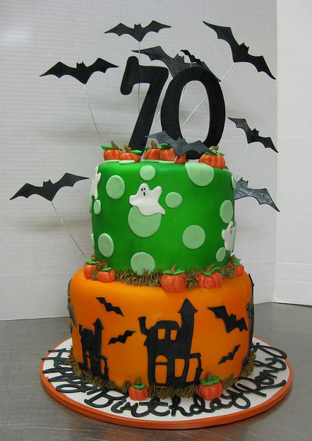 Halloween theme 70th birthday cake in two tiers.JPG