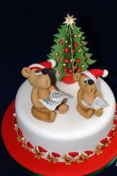 Christmas cake in white with tedding bears singing with Christmas tree.JPG