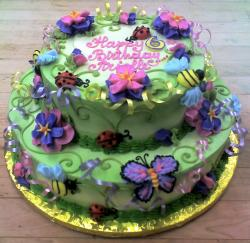 2 tier Green Garden birthday cake with butterflies & ladybugs for 6 year-old girl.JPG