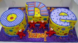 Baby Elmo First Birthday Cakes the word ONE spelled out.JPG