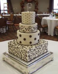 Four tier white cake with chocolate accent.JPG