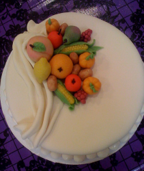 Cute Thanksgiving cake in white with full of fruits cake decor.PNG