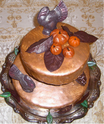 Picture of thanksgiving cake in two tiers with turkey and pumpkins cake toppers.PNG