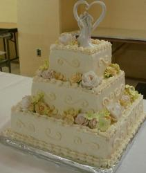 Three tier square ivory wedding cake with white flowers.JPG