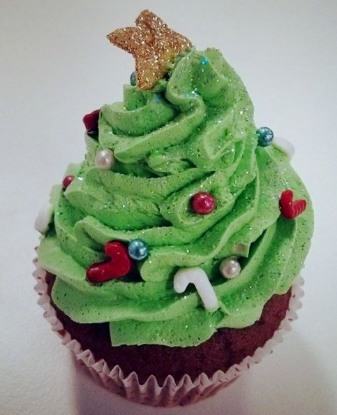 Christmas tree cupcake gold star on top.JPG