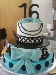 3 tier Sweet Sixteen birthday cake with teal ribbon.JPG